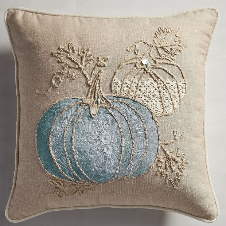 Go coastal this fall with a pillow that combines the best of the season with the seaside. Awash in creamy color, our embroidered pillow is an elegant addition to your sofa or chair—putting autumn front and center.