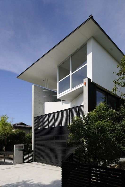 Awesome Modern Wood Fence Design Cover The Garden At Contemporary House With Wooden Main Door Design Under The House