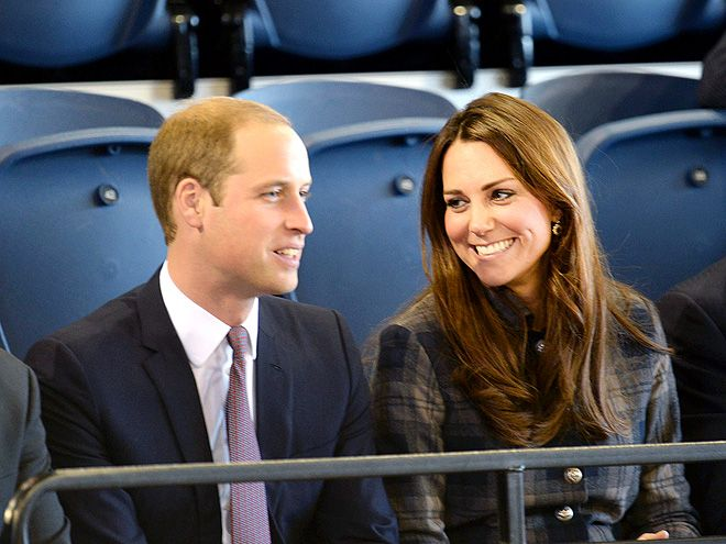 After a brief meet-and-greet, the Duchess of Cambridge and husband Prince William share a sweet moment inside the Emirates Arena Leisure Centre in Glasgow, Scotland