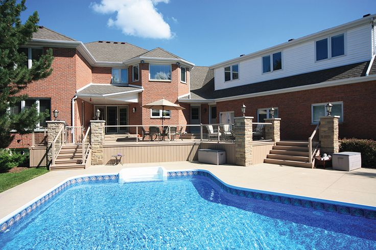 This is a nice design for a deck with an inground pool close beside. It is made with Azek composite decking and is in Kitchener/Waterloo.