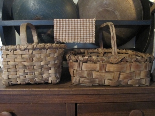 wonderful, old baskets and primitive bowl rack display...well used baskets show that they were valued.