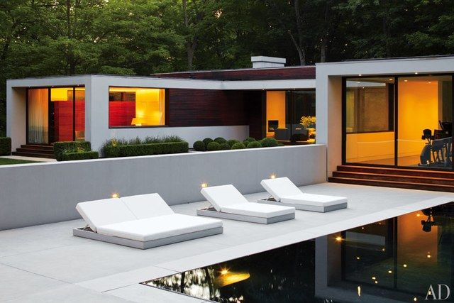 Lounge chairs from Gandia Blasco overlook the pool.
