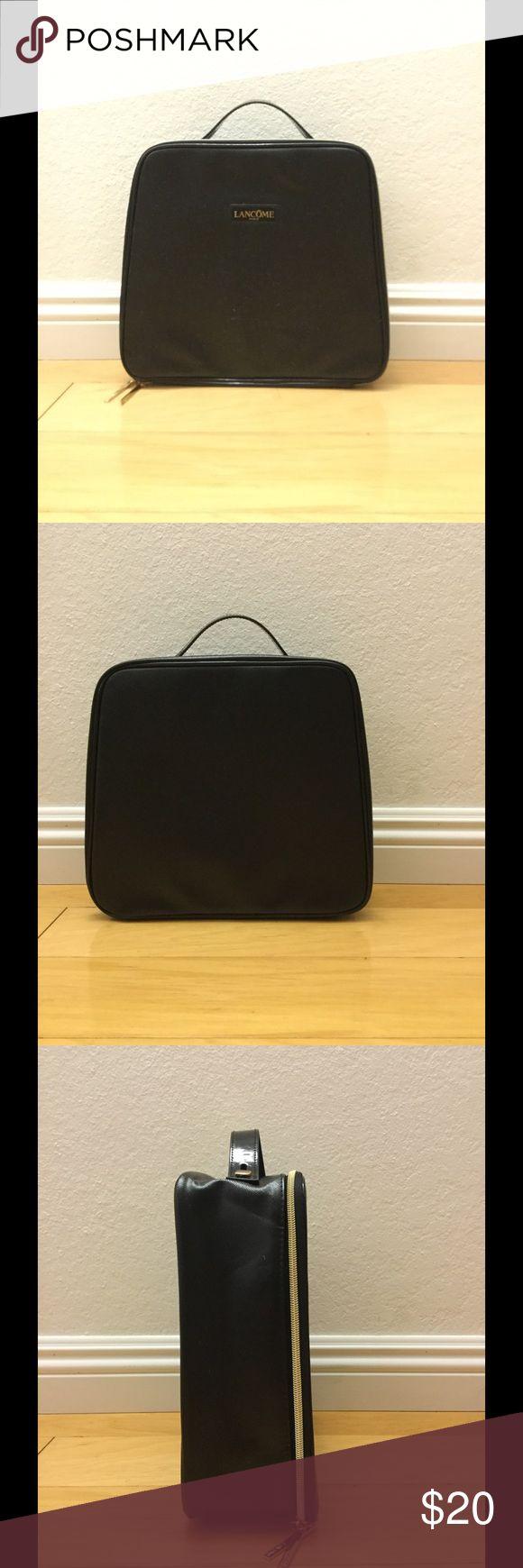 Lancôme black makeup bag NWOT Lancôme black makeup bag NWOT - comes with a small pink makeup bag inside Lancome Makeup