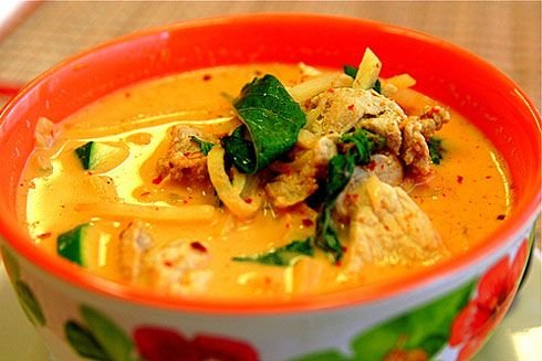 Red Thai Chicken Curry-- A dish of Red Thai Chicken Curry with nuggets of golden pumpkin and slivers of red bell pepper will surely stoke the fire in any belly. The chicken and vegetables are coated in a reduced and thickened sauce boasting of nutty, buttery, and citrusy flavors balanced against the sweetness of the pumpkin.
