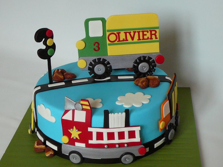 Trucks and car - My second cake with trucks and car theme for Olivier, 3 years old. This is a marble cake with chocolate ganache covered with fondant. All the details are fondant. I had a lot of fun making this cake!
