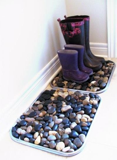 Glue river rocks to a dollar store baking tray for an inexpensive place to put dirty or wet shoes - just spray off with a hose when dirty