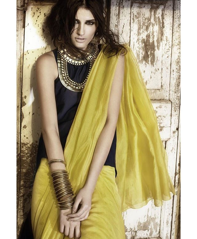 Gorgeous nargis fakri in mustard crepe Saree with plain black blouse teamed it…