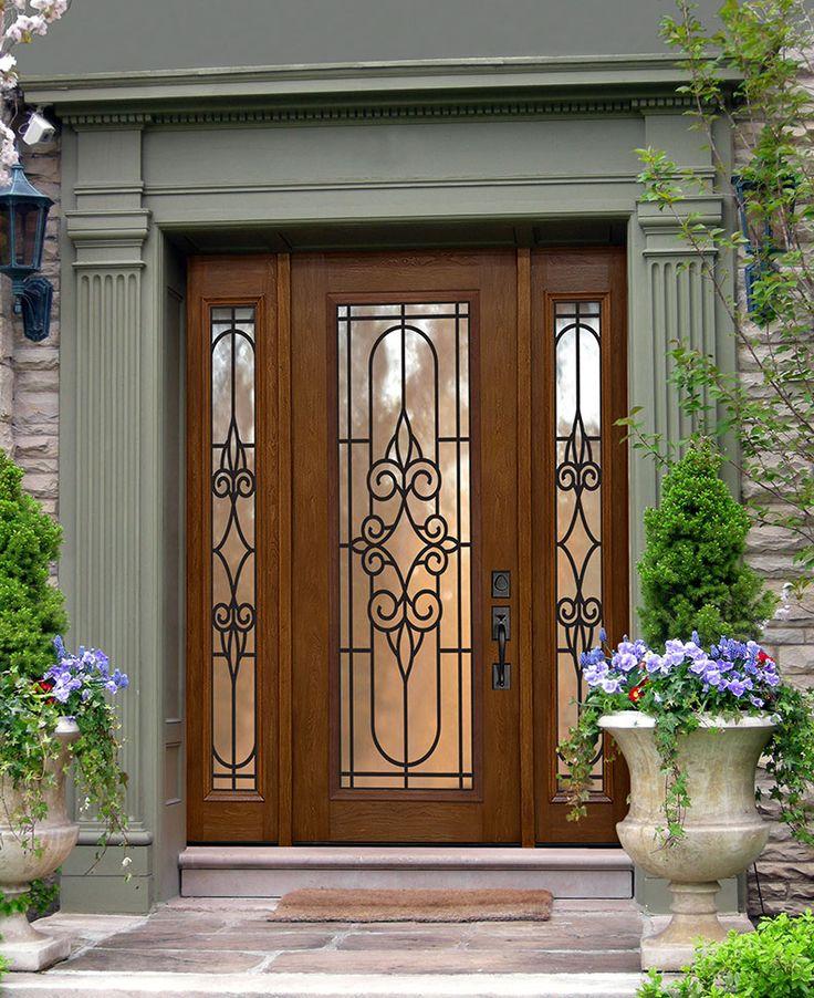 Stunning entryway with GlassCraft's premium fiberglass door with 2 sidelights in Salento GBG design.