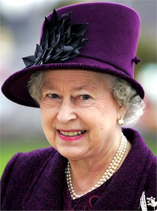 A deep rich purple that is so flattering to Her Majesty's fair skin.
