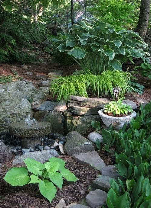 Shade Garden: Notice the combination of rock, water and greenery creates a shade garden is both moving and anchored in serenity..