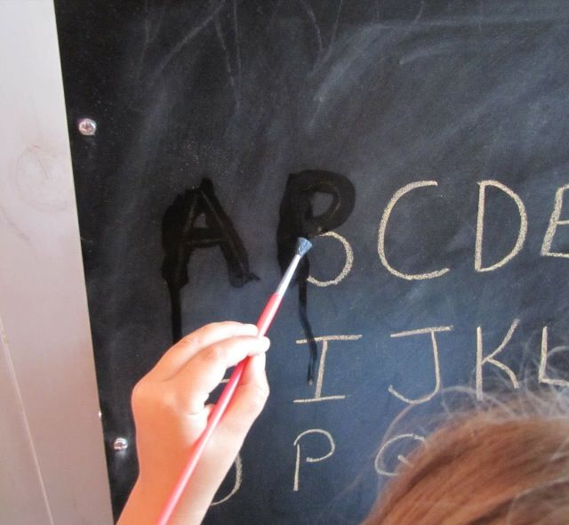 Learning letters - or letter sounds  Have child 'erase' with a wet paintbrush the letter that matches the sound you make