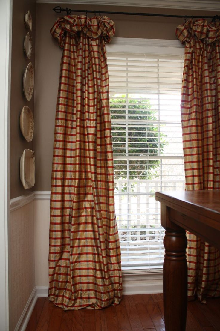 Love the curtains, the wainscoting, and the huge window.
