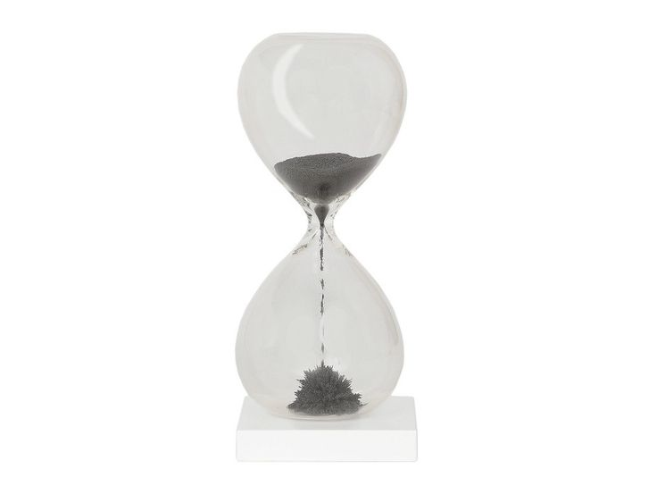 A small hourglass timer with charcoal black sand measuring 1 minute. With its magnetic stand, as the sand drops it forms mesmerising flower-like shapes.