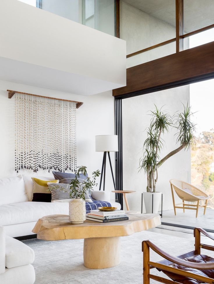 unique coffee table, boho-modern wall hanging, palm, + a view