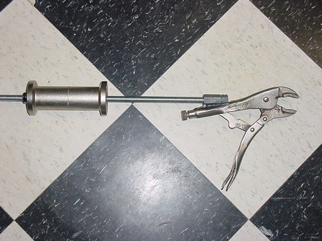 Vise-Grip Slide Hammer by HemiRambler -- Homemade slide hammer utilizing a pair of standard Vise-Grips for the head. A coupling nut has been welded near the end of the upper handle, while a length of threaded rod supports the slide. http://www.homemadetools.net/homemade-vise-grip-slide-hammer-2