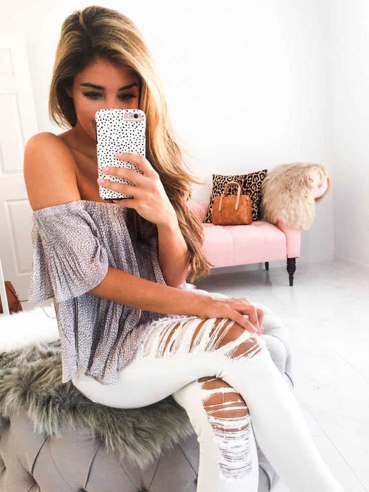 Love how this is classy yet sexy. And could be great for day time or night time. Love the distressed white jeans. The color of the top might be too light for me though.