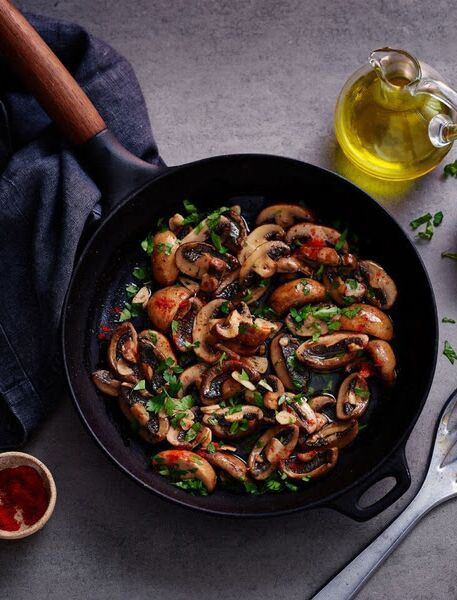 Make your mushrooms into an easy tapas dish spiked with garlic and sherry vinegar. #vegetarian #vegan