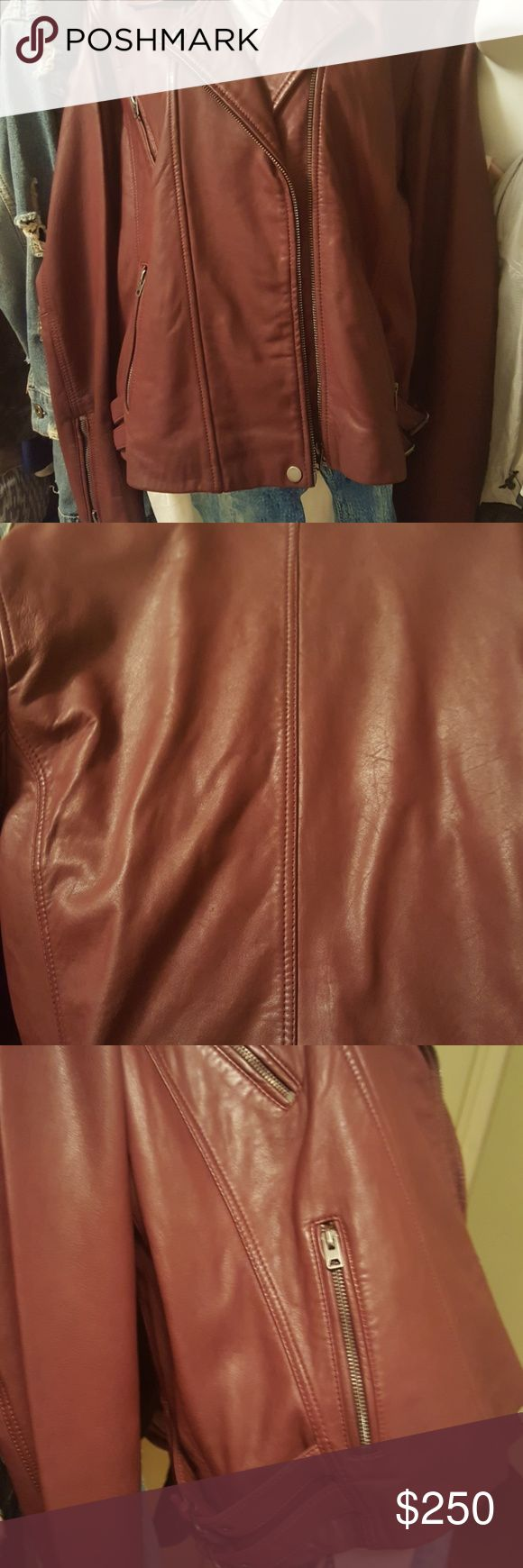 Lucky Brand Motorcycle Jacket Leather Motorcycle Jacket in Burgundy color.  Three pockets, double belts on side & zippers on sleeves for maximum comfort.  Offers Welcomed Lucky Brand Jackets & Coats Utility Jackets