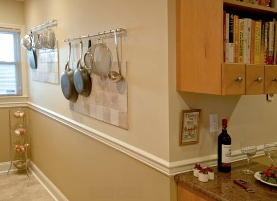 When we talk about easy, inexpensive ways to improve the storage in your kitchen — any kitchen, even a rental — a pot rack comes up quickly. Hanging your pots and pans for easy access frees up cupboards. But what if you, like me, are just too short for a traditional pot rack? I have tall friends with racks that loom high over their island or stove, but I am not tall enough to manage that! Here are 12 inspiring photos of other options: pot rails and racks, mounted on the wall, low enough for…
