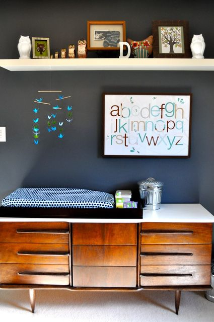 "Wow this is a chic ""changing table"".  And I bet via craigslist I can find an ultra cheap dresser, polish it up with a little love and paint, and make a very inexpensive DIY changing table instead of buying a new piece of furniture!"