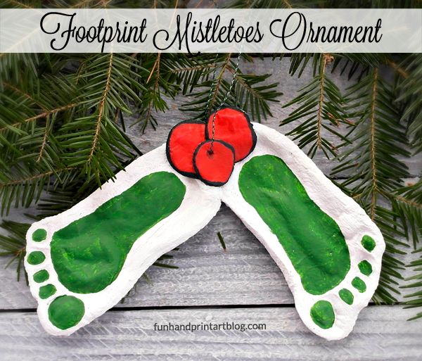 Easy salt dough recipe & tutorial for making a darling Mistletoe Footprint Ornament. It makes a memorable decoration to hang up on the tree every Christmas.