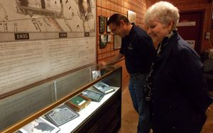 """""""La Vernia museum receives donations"""" -- Steven Schauer, manager of external communications for San Antonio River Authority, and historian Regina Kosub, admire part of the new exhibit made possible by a generous donation from SARA."""