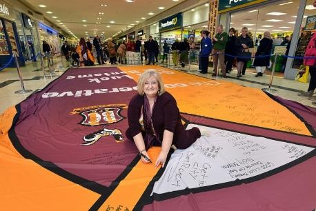 Kirkgate Centre manager Catherine Riley signs the giant replica Bradford City shirt