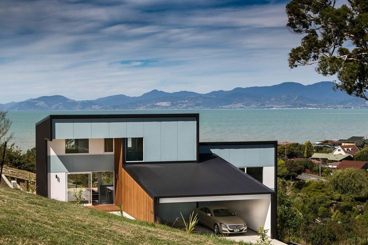 Block-like shapes and restrained use of materials and colour give this new home a crisp, geometrical look