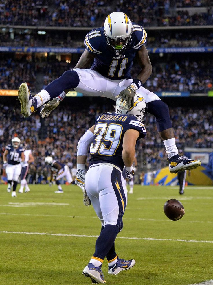 San Diego Chargers receiver Danny Woodhead (39) celebrates with receiver Stevie Johnson (11) after scoring on a 14-yard touchdown reception in the first quarter against the Chicago Bears in San Diego.  Kirby Lee, USA TODAY Sports