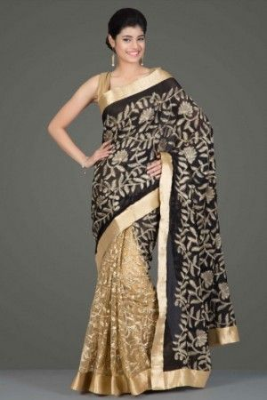 Rich black chiffon and gold net saree with floral embroidery and a gold border by gitanjalicreations
