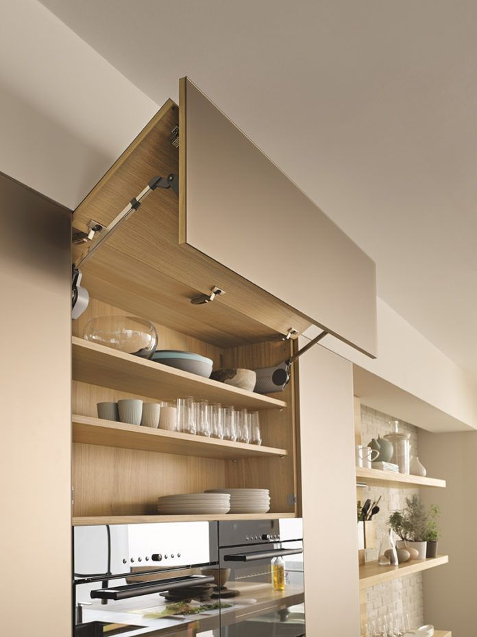 wall unit doors that go up you can leave them open when cooking without fear of walking in to your cupboard door