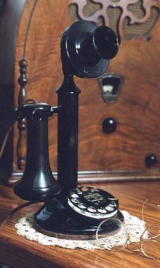 "The Classic ""Candlestick"" telephone, also known as the 'Upright' initially became popular during the early 1900s before the introduction of the one-piece handset. The first Candlestick phones were introduced when the magneto system was in use, which meant that the phone was connected to a large wooden box called a ""subset"" containing a battery, bell, and crank. ""Is this the party to whom I am speaking?"" ,>) #antique"