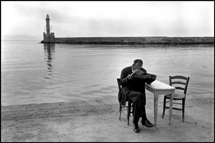 .Crete. Chania. 1962. Man reading newspaper. © Costa Manos/Magnum Photos