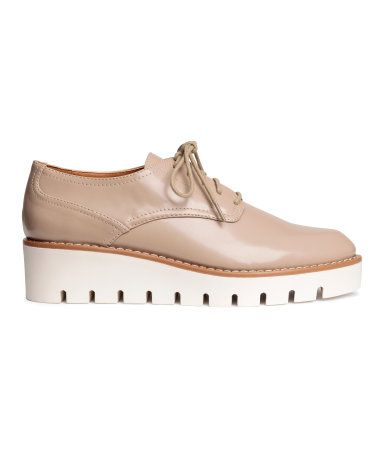 Light beige. Platform shoes in imitation patent leather with open lacing at…
