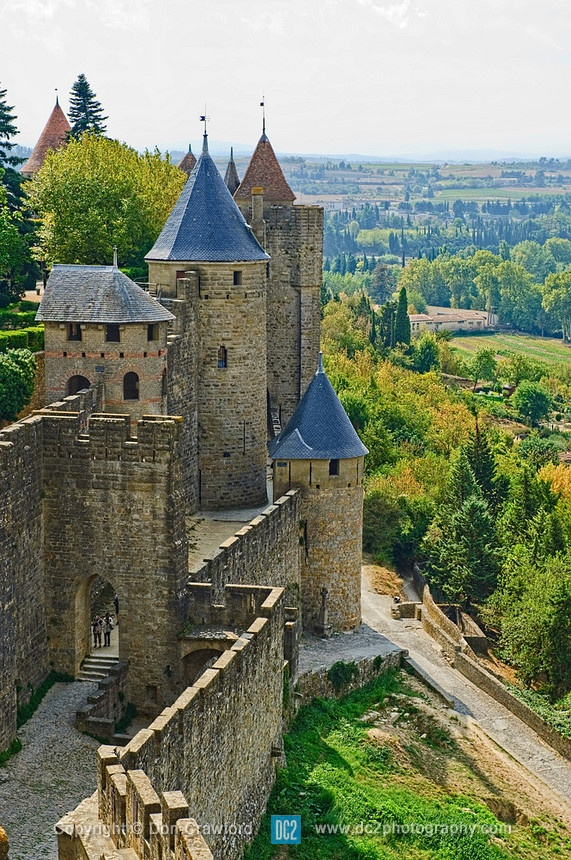 Fortified Chateu at Carcassonne France...Carcassonne is a fortified French town. Fortification consists of a double ring of ramparts and 53 towers. The fortress, was thoroughly restored in 1853 by architect Eugène Viollet-le-Duc, was added to the UNESCO list of World Heritage Sites in 1997.