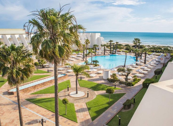 Iberostar Royal Andalus Novo Sancti Petri, Spain All-Inclusive Resorts Hotels sky grass property Resort palm tree arecales condominium tree shore palm lined