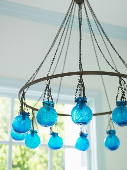 swoon for the glass color on this one of kind chandelier