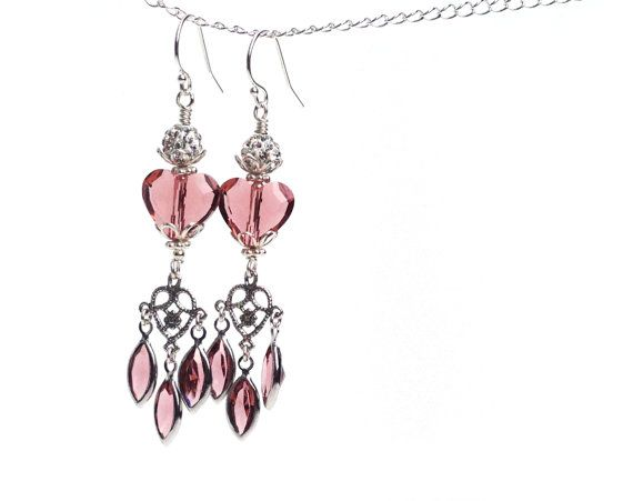 You cant get anymore romantic than these lovely chandelier earrings featuring blush rose swarovski crystals crowned with swarovski studded beads. The