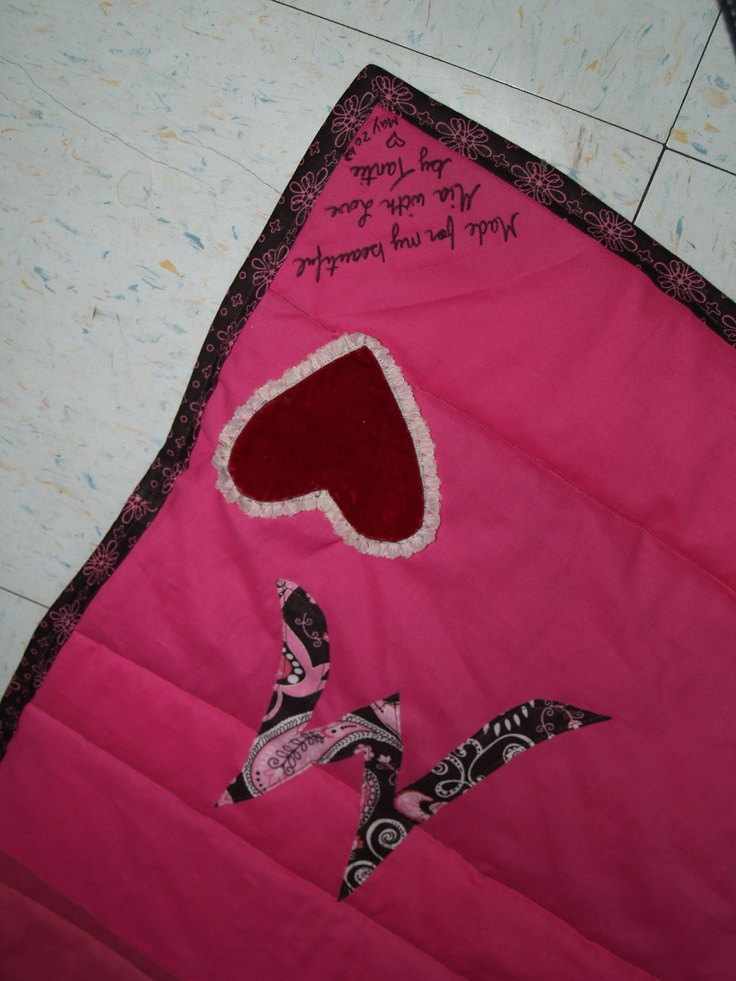 The back of Mia's quilt, with a heart taken from a pilliow that was made for me when I was little :)