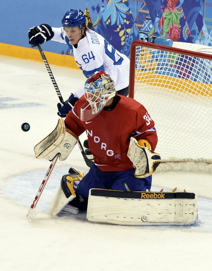 DAY 8: Lars Volden #34 and Mikael Granlund #64 of Finland compete during the Ice Hockey Men's Preliminary Round Group B - Finland vs. Norway http://sports.yahoo.com/olympics