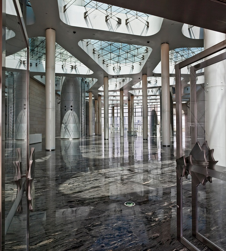 The main entrance foyer with the light columns, the transparent roof and the butterfly door handles on the main entrance doors.