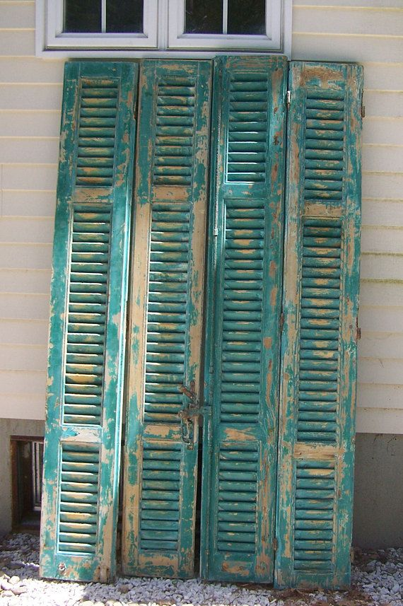 "vintage wood shutters,mediterranean shutters,four panels,chippy aqua blue green paint,reclaimed salvage window shutters,architectural art,2  ""great salvage/reclaimed wood shutters;original hardware wood shutters,window shutters;as is ""  you get all four panels!!!!  what a fabulous find... antique four panel shutter windows in a fabulous mediterranean aqua bluish green chippy paint, excellent architectural elements for your home or garden!with the original hardware and paint! dont miss ou..."