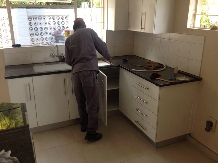 Stellenbosch kitchen renovation almost completed. We ripped the complete kitchen and floor tiles. Installed a new kitchen with Rustenburg black granite tops and new 600x600 floor tiles.