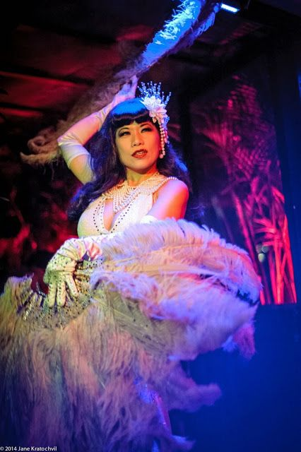 """Calamity Chang """"The Asian Sexsation"""" (glove detail, hairpiece detail)"""