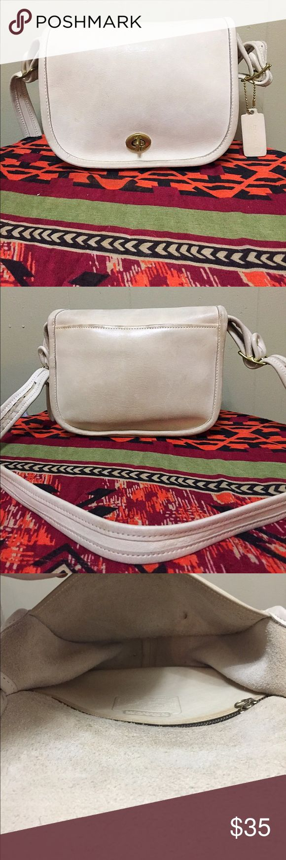 Vintage Coach Legacy Turn Lock Cream Crossbody. Vintage Coach Legacy Cream Turn Lock Crossbody. Shows some signs of wear and could use a polish. In overall great condition. Two interior pockets. Height 7.5 inches. Width 8.5 inches. Coach Bags Crossbody Bags