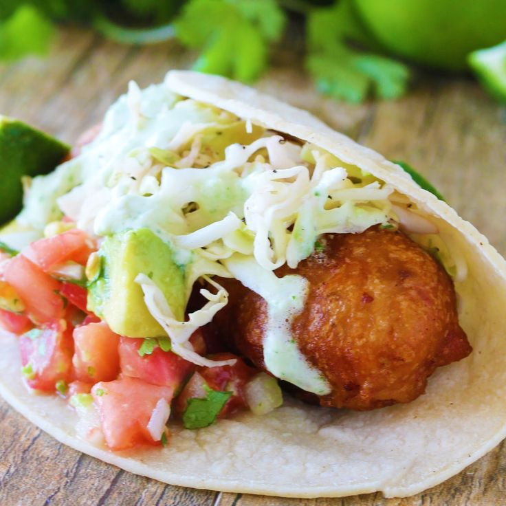 Flaky cod fish is battered and fried for the most delicious Battered Cod Fish Tacos. Top it off with a quick and easy jalapeno crema.