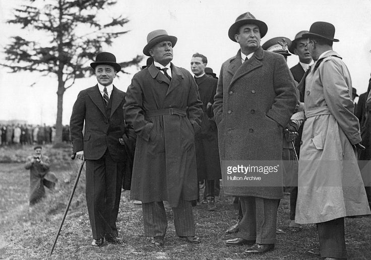 Italian dictator Benito Mussolini (1883 - 1945) (centre) in Italy with Austrian chancellor Engelbert Dollfuss (1892 - 1934) (left) who was murdered in 1934. To the right of Mussolini is Hungarian premier Gyula von Gombos.