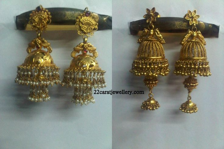 Checkout 22 carat gold traditional nakshi gold jumkas (earrins) studded with rubys and pearls .