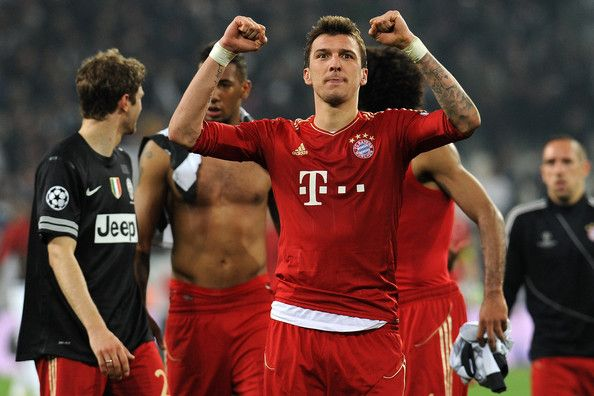 Mario Mandìukic of FC Bayern Muenchen celebrates victory at the end of the UEFA Champions League quarter-final second leg match between Juventus and FC Bayern Muenchen at Juventus Arena on April 10, 2013 in Turin, Italy.