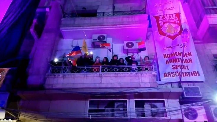 Is this Syria or Russia? Residents of west Aleppo flew flags in support of Putin's warplanes from their apartment balconies